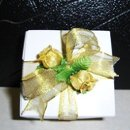 130x130 sq 1236260348546 whiteboxwithgoldribbon2