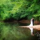130x130 sq 1416667721454 bride and groom embrace on river