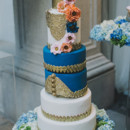 130x130 sq 1390517691759 550x826xelegant wedding blue gold cake.jpg.pagespe