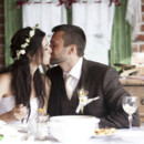 130x130 sq 1424383148648 bride groom eating with a kiss