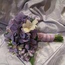 130x130 sq 1290051963678 purple1