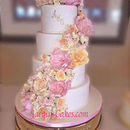 130x130 sq 1478539901 3e7290066fef0b6e khalid cascading flowers wedding cake edited 1