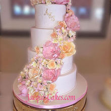 220x220 sq 1478539901 3e7290066fef0b6e khalid cascading flowers wedding cake edited 1
