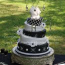 130x130 sq 1286114227732 blackwhitetopsyturvyweddingcake