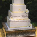 130x130 sq 1286116120951 whiteyellowsquaredaisyweddingcake