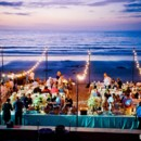 130x130 sq 1379025565117 welcome dinner on beach at sunset