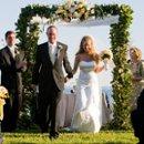 Newly weds on the shoreline.