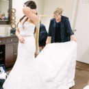 130x130 sq 1464092942773 bride dressing in bridal room cropped