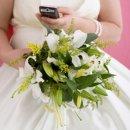 130x130 sq 1311881749483 bridewithphone