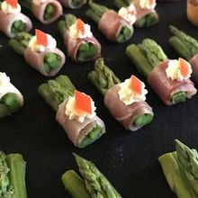 220x220 sq 1527193951 5c37adcfa29222a7 1487286406235 asparagus wrapped with proscuitto
