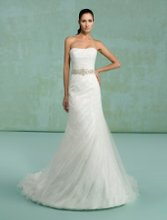 Kacie Style #H1010 Gown features strapless neckline, lace and beading.