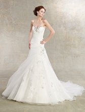 Tiffany Style #1217 Organza strapless gown adorned with beading at sweetheart neckline and on full skirt.
