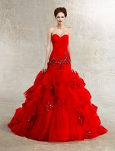 Autumn Style #1232 Strapless red ball gown with full pick up skirt adorned with beaded embellishments..