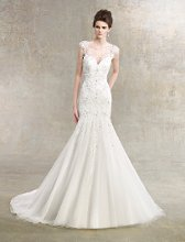 Caroline Style #K1207 Lace mermaid gown with beaded sweetheart bodice that flows into a tulle skirt. Illusion beaded and lace cap sleeves.
