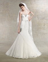Hope Style #K1210 Strapless tulle gown with beading that adorns sweetheart neckline and skirt. Bow belt accentuates natural waist.