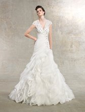 Valentina Style #K1224 Organza gown with beaded bust and cap sleeves. Ruched bodice and ruffled skirt.