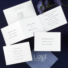 "All in White Wedding Invitations - The verse of your choice is featured on the front of this bright white z-fold invitation for a beautiful expression of your love. Your full names are showcased on the center panel and the rest of your wording is printed on the far right. Folded Size: 4 7/8"" x 3 1/2"" Tri-Fold"