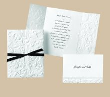 Elegant Filigree Wedding Invitations - Graceful filigree is deeply embossed on the front panels of this bright white gate-fold invitation. The panels open to reveal your wording printed inside. Seals shown are sold separately. Folded size: 4 1/2