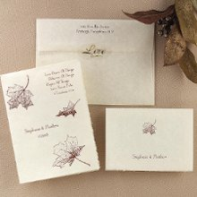 Falling In Love Wedding Invitations - Three delicate leaves gently adorn this lovely natural white parchment invitation, leaving a swirling trail to represent your journey into love. A classic deckle edge highlights your names and date on the front. A verse of your choice is printed in the upper right. The design will be printed as shown in the same ink color as your wording. Folded size: 4 1/2