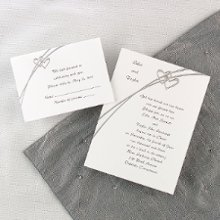 Love Struck Wedding Invitations - Silver-embossed hearts sweetly highlight your names at the top of this non-folding bright white invitation. Your wording is showcased beneath the design for a heartfelt introduction to your special day. Card Size: 5