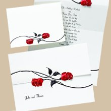 Red Roses Wedding Invitations - Two shimmery red foil roses with glossy black stems interlock above your names to beautifully close this natural white z-fold invitation. Folded size: 6 5/8