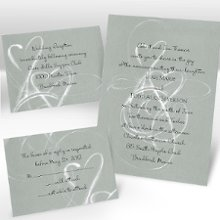 "Silver Purity Separate and Send Wedding Invitations - White hearts dance across this silver separate 'n send invitation forming designs of pure elegance. Separate 'n send invitations come with two detachable enclosure cards (respond card and reception card) on one convenient sheet. They also come with invitation envelopes and respond card envelopes for a complete, coordinated stationery set. Special Note: Separate 'n send enclosures are perforated for detaching from invitation. Invite: 5 1/8"" x 7 1/8"" Enclosures: 4 7/8"" x 3 9/16"" each"