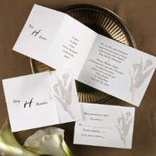 With Such Grace Wedding Invitations -Pearlescent calla lilies are embossed onto this bright white, z-fold invitation. Your names are printed on the front, a quote of your choice is printed on the center panel and your wording is printed on the last panel. Folded size: 4 7/16