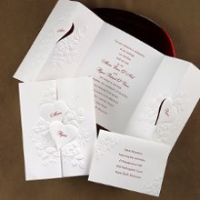 "The only way these hearts are separating is for guests to see when and where you'll be saying ""I do!"" Beautifully embossed interlocking hearts create the cover to this white, gate-fold invitation. * paper weight - quality 100# text * Includes FREE blank double envelopes * Enclosures sold separately Folded size: 5"" x 6 5/8"""