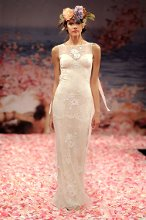 APHRODITE  <br /> Ivory beaded lace gown with blush silk lining and ribbons streaming from the shoulders.