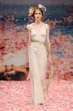MAIDEN  <br /> Ivory linen with guipure leaves and jeweled blossom shoulder with green ribbon waist sash. Also available with Ivory jewels, flowers and sash.