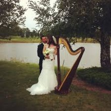 220x220 sq 1477617801294 couple with harp