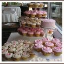 130x130 sq 1225234592359 th pink yellow cupcakes