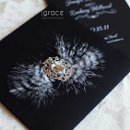 130x130 sq 1345503384154 blackandwhiteglamorouscrystalbroochweddinginvitation