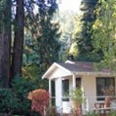 130x130 sq 1253578051364 cabinwithredwoods
