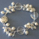 Large round Swarovski faceted crystals with smaller Swarovski pearls and crystals. Locking sterling silver clasp.
