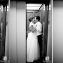 130x130 sq 1371590740399 kissing in the elevator