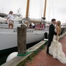 130x130 sq 1403714379672 kissing by sailboat