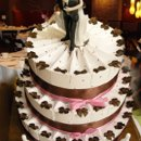 130x130_sq_1258048124130-polkadotfavorcakewithbride