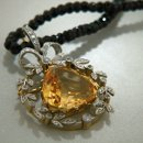 One of a kind vintage pear shaped citrine with diamond and yellow gold pendant setting.
