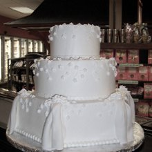 220x220 sq 1354296097536 3tierwhiteweddingcakeedited