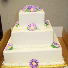 220x220 sq 1354296805761 purpleflowerweddingcakeedited