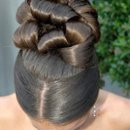 130x130_sq_1238772251790-updoprombridehairstylespicture076
