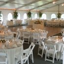 130x130 sq 1226344943348 tent.tables1