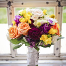 Fun and colorful bridal bouquet. Roses, Billy balls, callas, freesia and yes, those are dark purple carnations