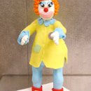 130x130 sq 1258918422132 standingclown
