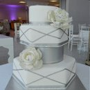 130x130 sq 1321236392560 silverpeoneyweddingcake
