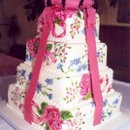 130x130_sq_1234470829628-handpaintedweddingcakewithbow