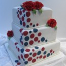 Pretty with polka dots (to match wedding invitations) and edible Freedom Roses. A fun wedding cake. Venue Dundas Valley Golf and Country Club