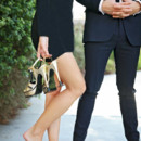 130x130 sq 1458585940684 blackhaongoldheelsinhandcouple
