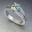 130x130 sq 1390595828464 diamond ring with blue topaz side stone
